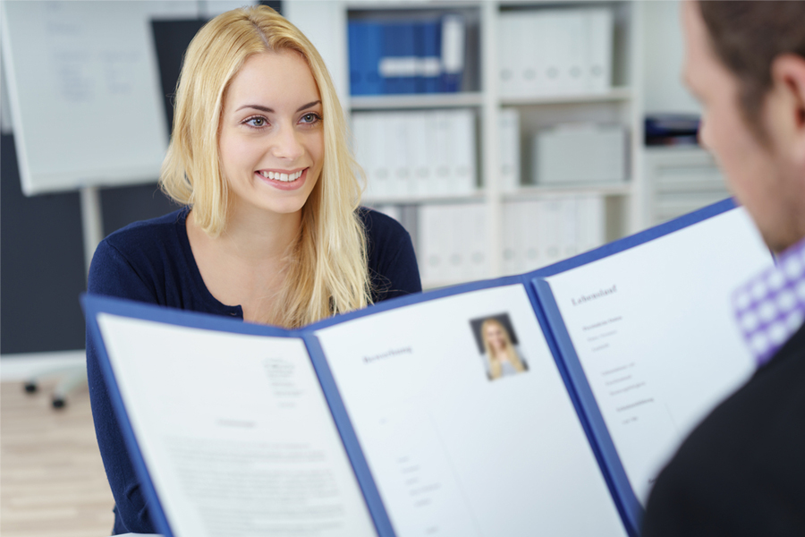A young woman with her CV.