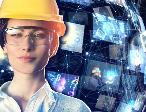 Female wearing a yellow hard hat with a computer screen image behind her